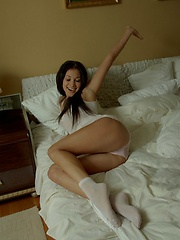 Camila lays naked in bed and makes her pussy buzz with her toy