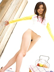 Asian teen cutie poses in pjs and gives a peek at her pussy