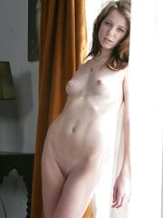 Sexy skinny girl Allie Rose moves apart her legs