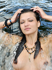 Gorgeous teen cutie showing her impressive tits and juicy round ass in a turbulent river.