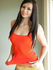 Young babe Natasha Belle in orange shirt
