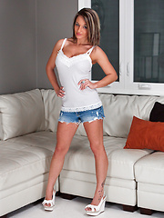 Nikki wearing shorts and tank for hot solo scene