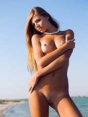 Another beach-loving babe, Iveta may look sweet and innocent but she also has a naughty side, posing and stripping naked in the beach showing of her gorgeous body is one of her favorite things to do.