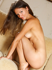 Zhanet playfully lifts the hem of her sheer black nightie to playfully preview her tight ass before fully undressng in front of Alex Sironi\'s lens to showcase her tanned and well-toned body with cuppable, perky breasts, sexy slim waist, and svelte legs.