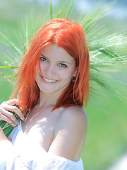 Surrounded by vast green grass, Violla\'s alluring beauty and charmingg allure stands out, with her pale smooth skin, fiery red hair, pink, perky boobs, and delectable labia.