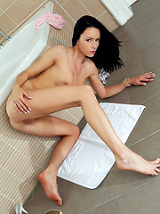 Gwen sensually strips her pink shirt and white lingerie and shamelessly spreads her sexy legs and bares her arousing assets in a variety of erotic poses inside the bathroom.