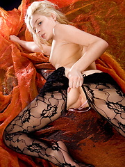 The stunning blonde Guerlain delivers yet another erotic shoot, stripteasing her black lacy lingerie flaunting her alluring and tempting body in front of the camera.