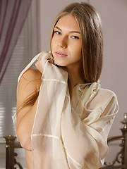 Katherine stunning beauty and irresistable allure stands out in simple but elegant bedroom setting.