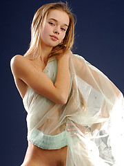 Milena is a shy girl who has trouble showing her wonderful features like young glowing skin and a spankable bottom.