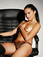Olga has the sleek killer looks of a naked corporate raider.