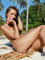 Anna is an island princess , tall , lean , and lightly tanned, she has a gorgeous ass that she sticks out or puts in the sand.
