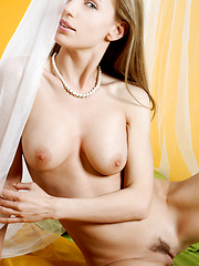 Young model with brown hair and medium breasts has a new set of white sexy under clothes.