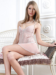 Katherine sensually strips her sheer pink baby doll dress and matching panties.