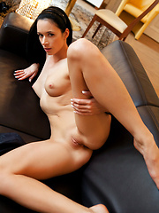 Dark-haired girl shows her shaved pussy