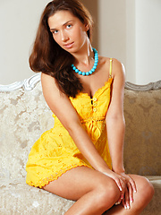 Zhanna is a petite sizzler who can arouse your deepest fantasies with her sexy poses and deep, sultry look.