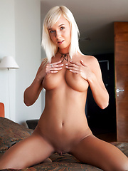 Gorgeous platinum blonde with perfect tan all over even her hairless pussy.