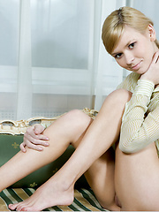Cute blond girl Paloma spread her sexy legs and shows her shaved pussy
