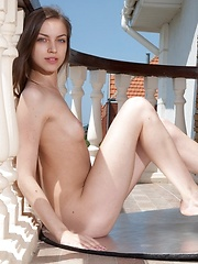 Playful cute girl Sofy  shows her pussy