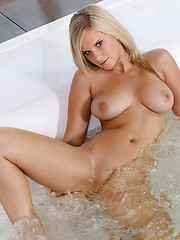 Miela indulges her sexy body with a warm, relaxing bath, making sure her large, luscious twins, and round rump are nice and wet for all of you to enjoy.