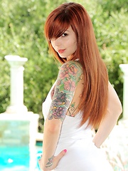 Ivy Snow wears a tight white dress and reveals she has on no panties while she plays with her dildo