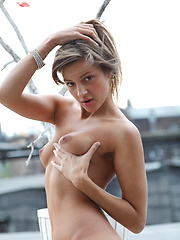 Cute girl Melena shows her sexy naked body on a roof top