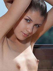 Luiza spreads her sexy long legs and bares her delectable assets in a variety of erotic poses all over the veranda.