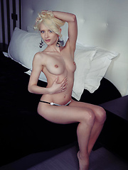 Flowing blonde hair, beautiful blue eyes, slender physique, and lean, athletic body makes Nika a deity naked in bed.