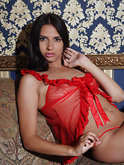 Natania makes a sensual strip tease with   her gorgeous tanned body with defined   hips, and long, athletic legs.