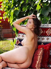 Anita shows off her playful side as she   strips her sexy lingerie with a   combination of stylized poses and   natural allure outdoors.