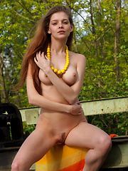 Indiana poses confidently outdoors   showcasing her gorgeous physique   and beautiful breasts with perky   nipples and baring her sexy curves   in front of the camera.