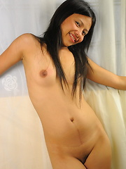 Young Dina strips and spreads to flash her love orifices