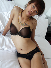 Ridiculously tight and horny young Thai babe strips and touches herself