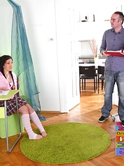 Vika is in the school room after misbehaving, with a pink top and a sexy plaid skirt.