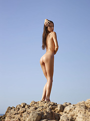 Kiki is posing naked in top of a rock! With her, the sky is the limit!