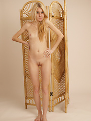 Adorable teen blonde strips out of her sexy lingerie and fingers her tight shaven pussy.