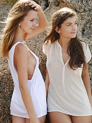 Lucia D and Ryanel A enjoy each other's bodies in the sand