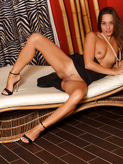 Dominika A indulges her viewers in a sensual and spontaneous tease, displaying her gorgeous, bronzed body and oh-so-yummy, shapely limbs as she sprawl on the sofa.
