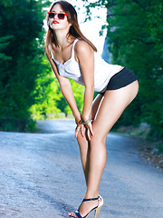 With her sultry red lips, fun and carefree attitude, Miela is a traffic-stopping bombshell, especially when she starts taking off her skimpy clothing and posing provocatively.