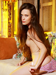 Stunning blue eyes with hypnotizing gaze, Amelie B will set your heart and fantasies on fire as she sensually strips off her meager clothing and starts flirting naked in front of the camera.