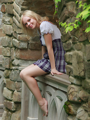 Feeona A dazzles you with the little school girl look. Outfitted in a blue plaid dress with a little white bodice and no panties she shows off her perfect petite body.
