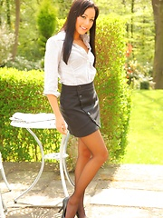 Beautiful Lily S flaunts her sexy curves in her white shirt and grey miniskirt.