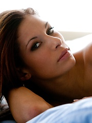 Cayton Caley - lies in bed against the soft sheets
