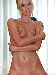 Gorgeously tanned skin, sweet puffy breasts, round curvy butt, and an exquisite, shaved pussy, Tracy A is an eye candy
