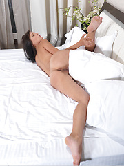 Pretty Yarina A strips off her panty and shows off her shaved pussy