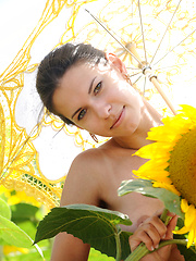 Suzanna A\'s carefree allure and charming beauty stands out amidst a field of sunflowers