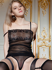 Mila I performs an exciting striptease of her sheer black ensemble