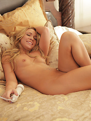 Blonde babe Katerina Kay finger fucks her soft bald pussy and then satisfies her orgasmic urges with a vibrating toy