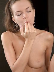 Candy Julia spreads open her sweet pussy and slips a finger inside
