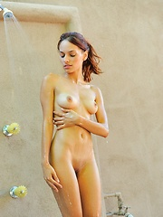 Valerie plays naked in a park