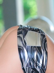 Sex kitten Catie Minx  in and out of  a silver metal bikini